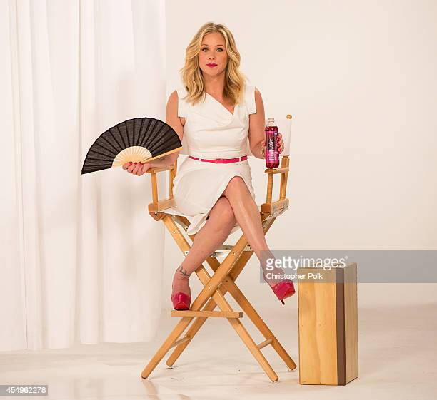 Christina Applegate steals a moment to hydrate joke around and save the day on set of a recent Fruitwater ad campaign September 8 2014 in Los Angeles...