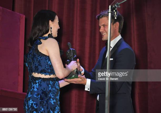 Christina Bennington accepts the Evening Standard Radio 2 Audience Award for Best Musical from Jeremy Irvine at the London Evening Standard Theatre...