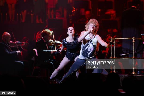 Christina Bennington and Andrew Polec sing 'Bat out of hell' at 'Magic At The Musicals' concert held at Royal Albert Hall on May 21 2018 in London...