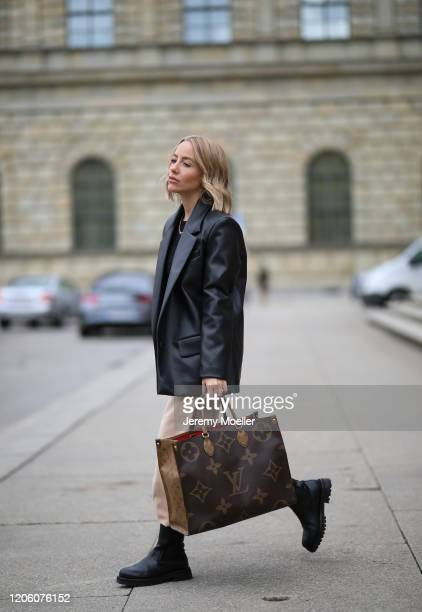 Christina Biluca wearing & other stories boots, Edited pants, Louis Vuitton bag and Zara leather blazer on February 13, 2020 in Munich, Germany.