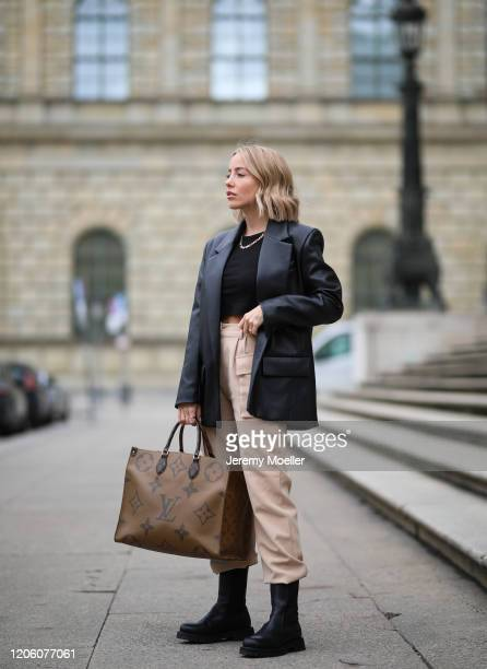 Christina Biluca wearing other stories boots Edited pants Louis Vuitton bag and Zara leather blazer on February 13 2020 in Munich Germany