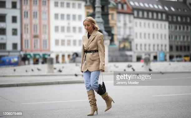 Christina Biluca wearing Zara jeans and overknees Prada bag and Arket blazer on February 13 2020 in Munich Germany