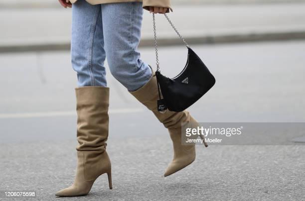 Christina Biluca wearing Zara jeans and overknees, Prada bag and Arket blazer on February 13, 2020 in Munich, Germany.