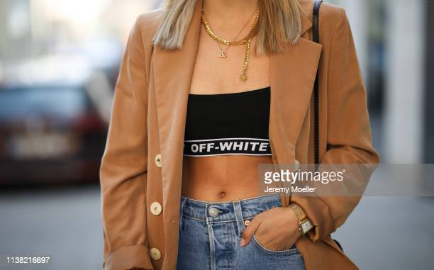 Christina Bischof wearing Mango blazer, levis 501 skinny jeans, top offwhite, kapten & son glasses and Black Palms chain on March 24, 2019 in Munich,...