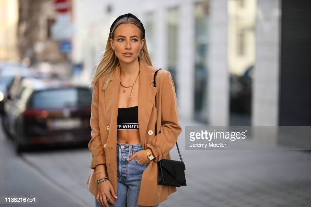 Christina Bischof wearing Mango blazer levis 501 skinny jeans ysl bag top offwhite kapten son glasses and Black Palms chain on March 24 2019 in...
