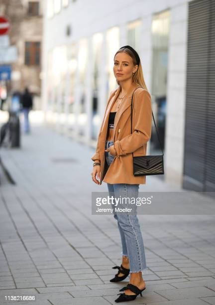 Christina Bischof wearing Mango blazer levis 501 skinny jeans Zara heels ysl bag top offwhite kapten son glasses and Black Palms chain on March 24...