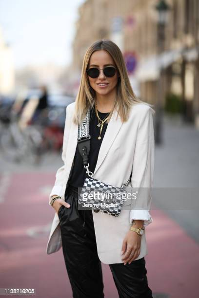 Christina Bischof wearing Mango blazer Zara leather pants Dior bag black shirt from other stories kapten son sunglasses and Black Palms chain on...