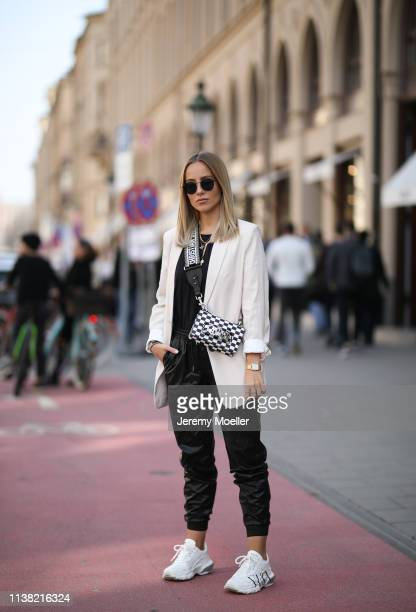 Christina Bischof wearing Mango blazer Zara leather pants Valentino sneaker Dior bag black shirt from other stories kapten son sunglasses and Black...