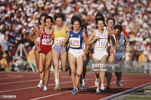 Christina Boxer of Great Britain Gabriella Dorio of Italy and Doina BesliuMelinte of Romania race in the Women's 1500m metres event at the XXIII...