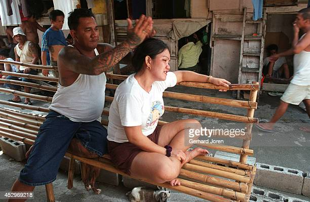 Christina Bunuan receives a massage from her husband Joey at their barrack in the Manila City Jail Sputnik is one of the four major gangs in Manila...