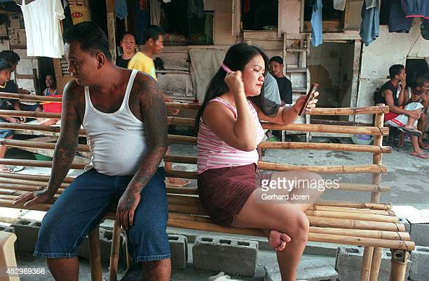 Christina Bunuan with her husband Joey at their barrack in the Manila City Jail Sputnik is one of 4 major gangs in Manila City Jail Joey is the...