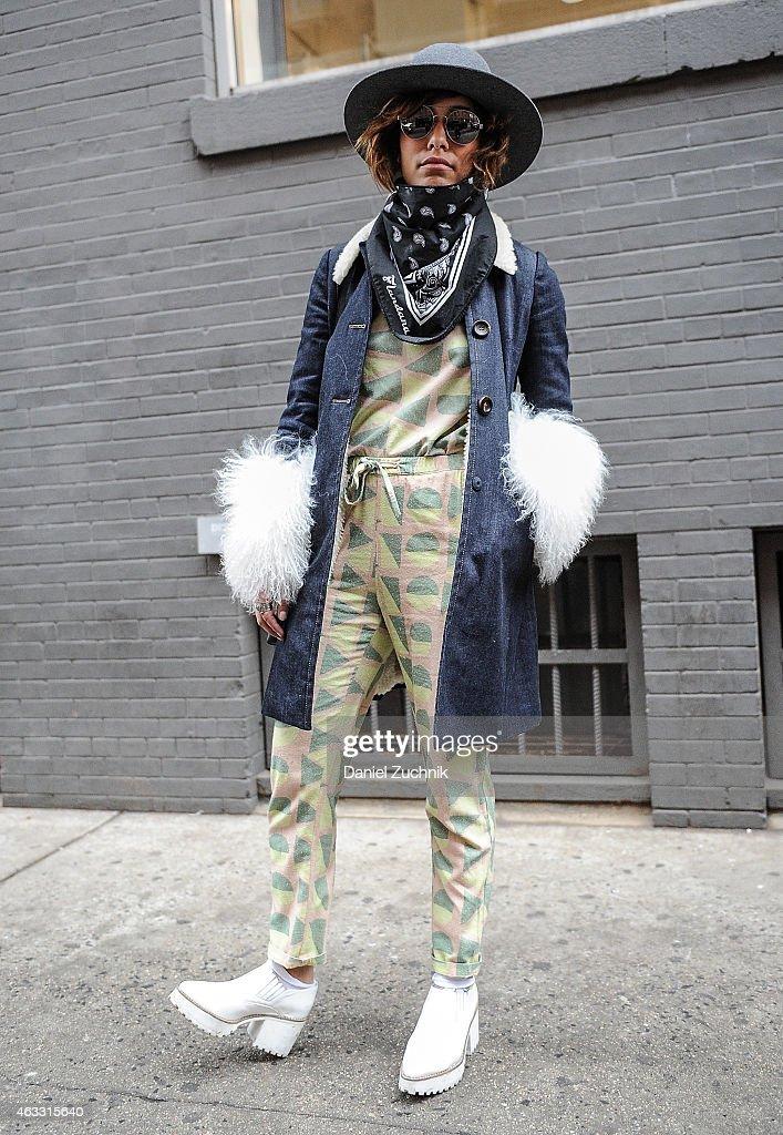 Christina Caradona is seen outside the Marissa Webb show wearing a Miu Miu coat and Samuji top and pants on February 12, 2015 in New York City.