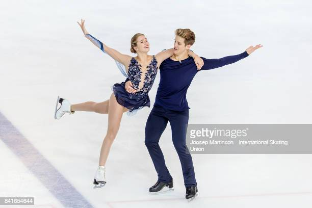Christina Carreira and Anthony Ponomarenko of the United States compete in the Junior Ice Dance Free Dance on day 2 of the ISU Junior Grand Prix of...