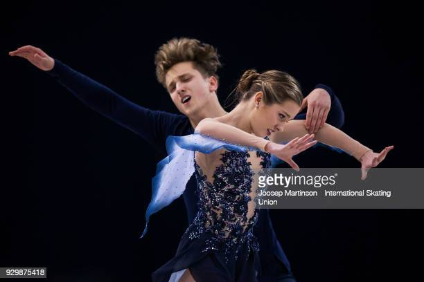 Christina Carreira and Anthony Ponomarenko of the United States compete in the Junior Ice Dance Free Dance during the World Junior Figure Skating...