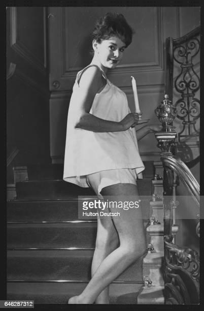 Christina Creeg models a set of short pale pink pajamas at a show of spring and summer fashions by Kayser Bondor London January 1959
