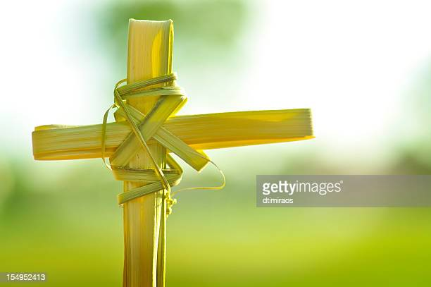 christina cross made out of palm fronds. - palm sunday photos stock pictures, royalty-free photos & images