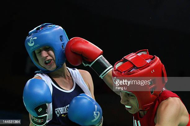 Christina Cruz of the United States fights against Shora Rezaie Jahroni of Norway in the Women's 54kg preliminary match during the AIBA Women's World...