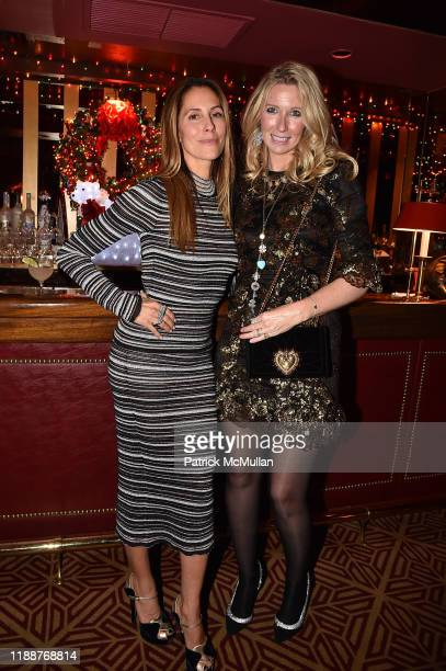 Christina Cuomo and Mary Snow attend Anne Hearst McInerney Jay McInerney and George Farias Host Christmas Cheer at Doubles Club on December 13 2019...