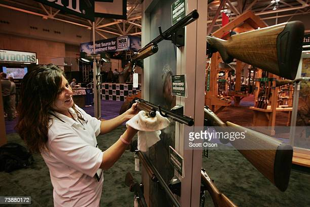 Christina Day polishes Franchi shotguns prior to the opening of the 136th NRA Annual Meetings and Exhibits April 13 2007 in St Louis Missouri The...