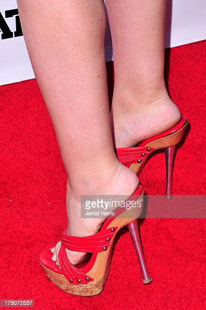 """Christina De Rosa arrives at the premiere of """"The Motivation"""" at ArcLight Hollywood on July 30, 2013 in Hollywood, California."""