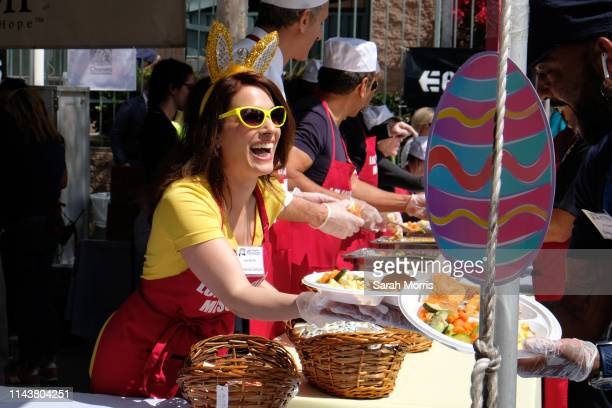 Christina DeRosa serves food as The Los Angeles Mission hosts Easter for the homeless on April 19, 2019 in Los Angeles, California.