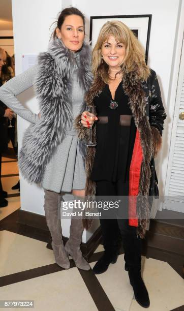 Christina Estrada and Carole Ashby attend a private view of Koo Stark's exhibition 'Kintsugi Portraits' at Galleria San Lorenzo on November 23 2017...