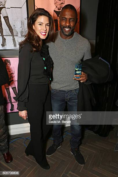 Christina Estrada and Idris Elba attend a private view of BritishAmerican pop artist Russell Young's new exhibition Superstar at The Halcyon Gallery...