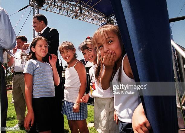 Christina Estrada Jasmine Gutierrez Amanda Sanchez and her cousin Angelika Sanchez share a laugh as they wait to greet Mayor Wellington Webb...