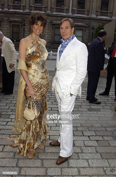Christina Estrada-Juffali and Tommy Hilfiger attend the Around The World party at The Royal Academy on June 21, 2004 in London. David Tang hosts the...