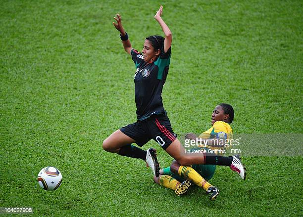 Christina Ferral of Mexico battles with Rachel Sebati of South Africa during the FIFA U17 Women's World Cup Group B match between Mexico and South...