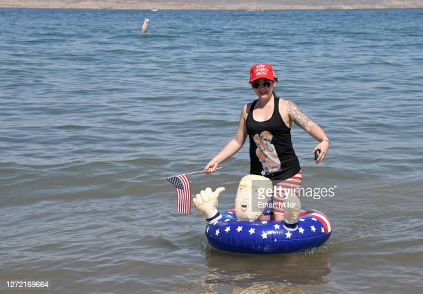 Christina Hamm of Nevada uses a Donald Trump float as she watches boaters participate in a boat parade on Lake Mead near Boulder Beach in support of...