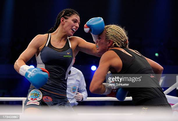 Christina Hammer from Germany and Mikaela Lauren from Sweden fight during the WBO WBF Middleweight World Championship fight between Christina Hammer...
