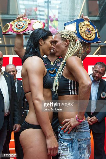 Christina Hammer from Germany and Mikaela Lauren from Sweden pose during the weighin for the WBO WBF Middleweight World Championship on July 12 2013...
