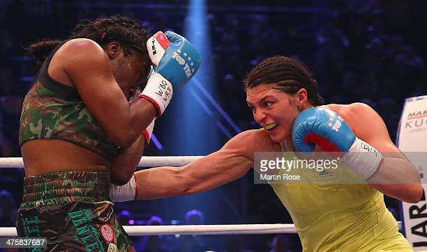 Christina Hammer of Germany and Jessica Balogun of Germany exchange punches during the WBO WBF World Championship Middleweight title fight at Getec...