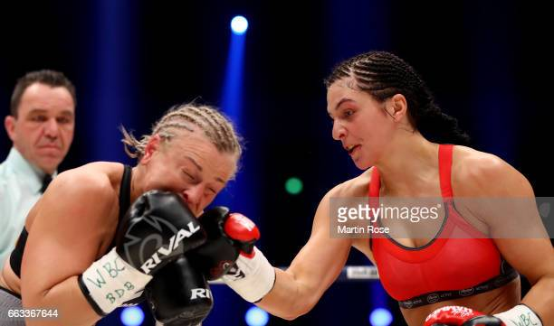 Christina Hammer of Germany and Maria Lindberg of Sweden exchange punches during their WBC middleweight World Championship title fight at...