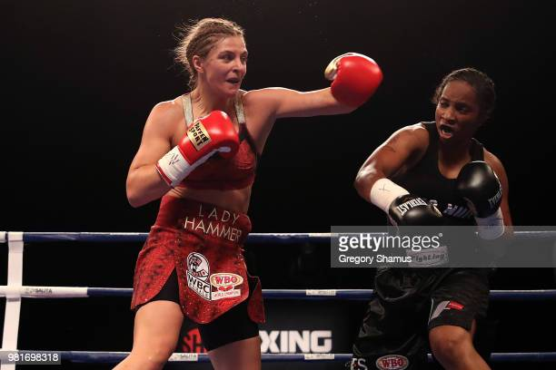 Christina Hammer of Germany battles Tori Nelson in the second round during their WBC and WBO world middleweight championship fight at the Masonic...