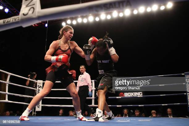 Christina Hammer of Germany battles Tori Nelson in the seventh round during their WBC and WBO world middleweight championship fight at the Masonic...