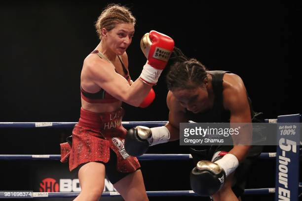 Christina Hammer of Germany battles Tori Nelson in the third round during their WBC and WBO world middleweight championship fight at the Masonic...