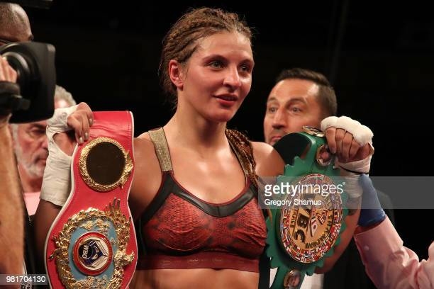 Christina Hammer of Germany celebrates winning her WBC and WBO world middleweight championship by defeating Tori Nelson at the Masonic Temple Theater...