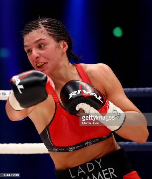 Christina Hammer of Germany in action against Maria Lindberg of Sweden during their WBC middleweight World Championship title fight at Westfalenhalle...
