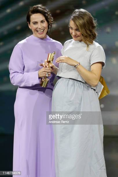 Christina Hecke congratulates Luise Heyer winner of the best female supporting role award reacts on stage during the Lola German Film Award show at...