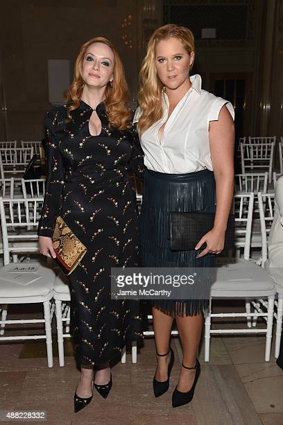 Christina Hendricks and Amy Schumer attend the Zac Posen Spring 2016 fashion show during New York Fashion Week at Vanderbilt Hall at Grand Central...