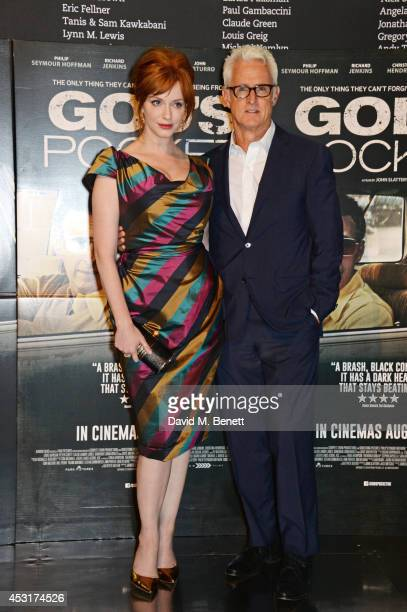 Christina Hendricks and director John Slattery pose at a photocall for God's Pocket at BFI Southbank on August 4 2014 in London England