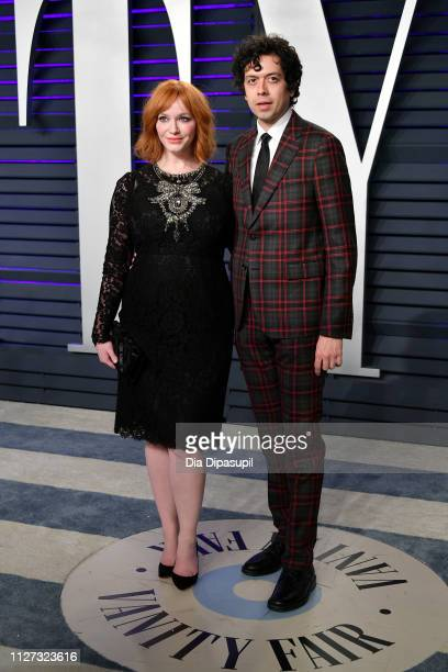Christina Hendricks and Geoffrey Arend attend the 2019 Vanity Fair Oscar Party hosted by Radhika Jones at Wallis Annenberg Center for the Performing...