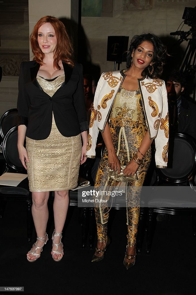 Christina Hendricks and M.I.A. attend the Versace Haute-Couture Show as part of Paris Fashion Week Fall / Winter 2012/13 on July 1, 2012 in Paris, France.