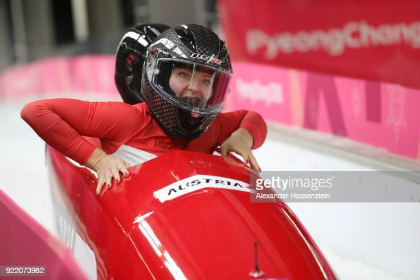 Christina Hengster and Valerie Kleiser of Austria react in the finish area during the Women's Bobsleigh heats on day twelve of the PyeongChang 2018...
