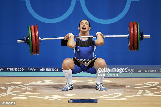 Christina Ioannidi of Greece lifts in the women's 75 kg category weightlifting competition on August 20 2004 during the Athens 2004 Summer Olympic...