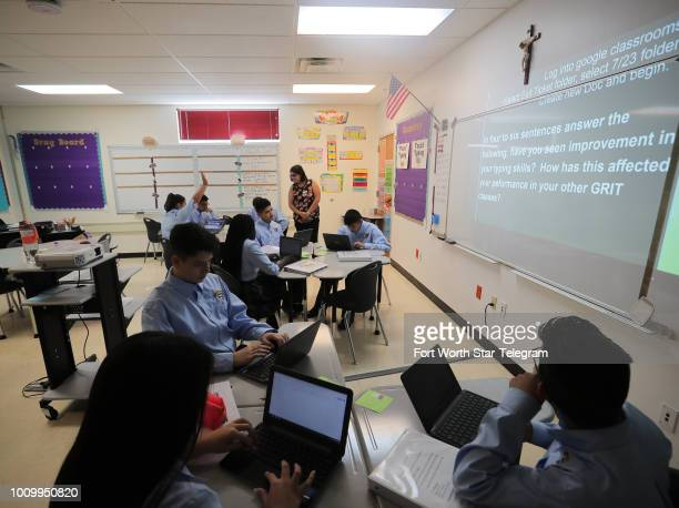 Christina Jaquez who will teach algebra and geometry during the year teaches typing during a basic skills training session at Cristo Rey High School...