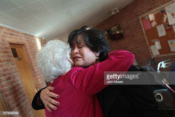 Christina Kent embraces a fellow congregation member ahead of a church service at the Mountain Avenue Church of Christ on January 9 2011 in Tucson...