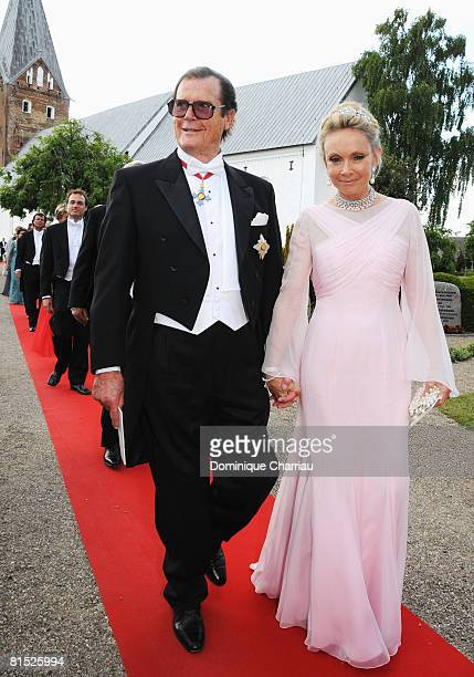 Christina 'Kiki' Tholstrup and Roger Moore arrive to attend the wedding between Prince Joachim of Denmark and Marie Cavallier on May 24 2008 at the...